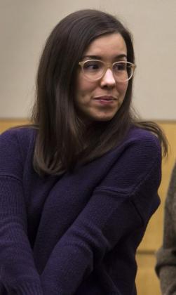 Jodi Arias greets the jury